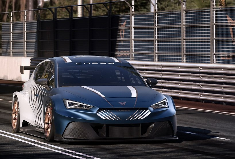 new CUPRA Leon e racer fully electric sports car with no emissions side view on race track